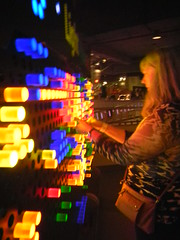 Laura plays with the Lite Brite