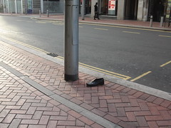 abandoned shoe in the morning