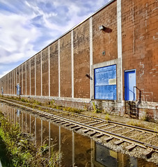 Even when opportunity knocks a man still has to get up off his seat and open the door  Unknown (Canadian Wendy 24 taking the summer off) Tags: railwaytracks 3doors soundtrackmonday nestlesbuilding