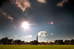 It's Always Sunny in Baton Rouge (geauxLSU) Tags: sun silhouette horizontal clouds landscape bright flags motionblur lensflare tigerstadium sunflare memorialtower generalcampus epdigitalcolor paradegrouds