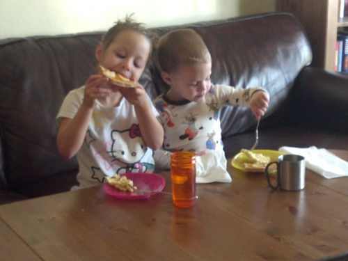Daisy and Billy eating lunch in the living room