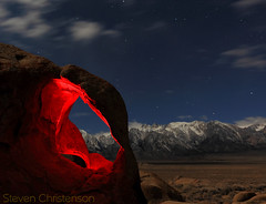 Maw of the Cyclops [C_039953] (Steven Christenson) Tags: california nightphotography blue red sky brown white snow lightpainting clouds stars cyclops workshop lonepine doublearch alabamahills earthandspace stevenchristenson starcircleacademycom ahsca2011 mawofthecyclops
