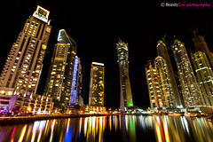 UAE - Dubai Marina (Beauty Eye) Tags: light sea reflection beautiful night skyscraper dark restaurant mix rainbow dubai yacht walk uae dubaimarina    marinawalk  platinumheartaward  flickraward5 flickrawardgallery