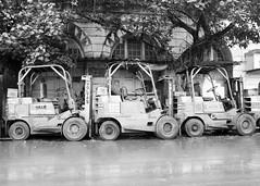 Mumbai, September 1999 (Riverman___) Tags: travel blackandwhite india blancoynegro film wheel truck 50mm md minolta 28mm 400 bombay hp5 mumbai ilford fp4 forklift 125 x700 f17 rokkor