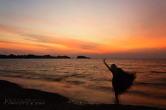 Dancing on the Beach (Chrisseee) Tags: longexposure travel sunset sea orange woman black beach silhouette canon landscape thailand evening asia dancing kohlanta selfie longdress kawkwang kristiinahillerstrm chrisseee