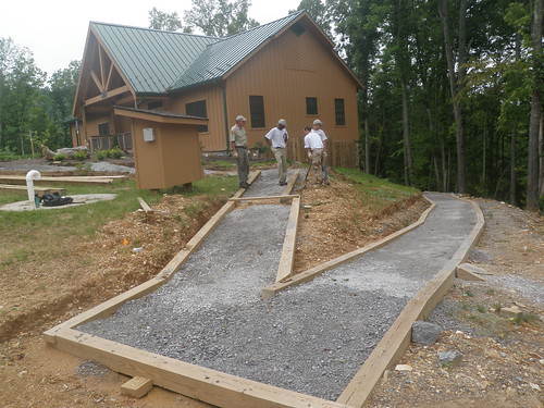The Natural Tunnel Crew work on an accessible walkway from the lodge to a picnic pad
