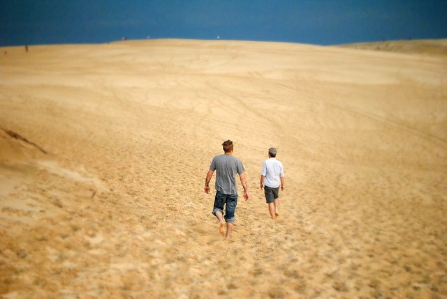 dad + andrew climbing the dunes