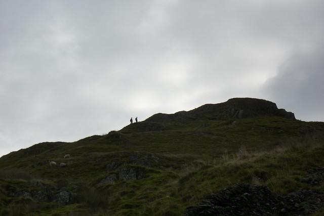 Walkers approaching the summit of Wansfell