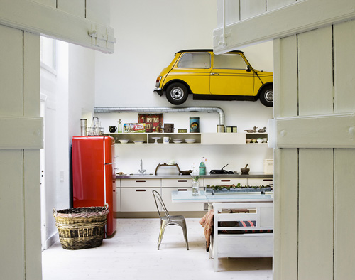 There Is A Car In The Kitchen.