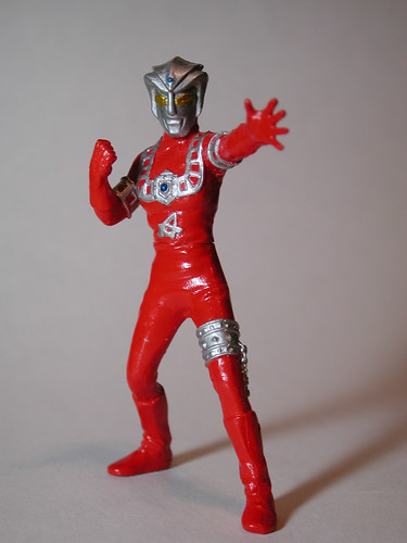 A plastic hero figurine painted in red