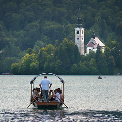 A tradition Pletna boat dating back to the 12th Century (Bn) Tags: travel blue girls summer two mountain lake holiday alps castle feet water swim island swan topf50 women hiking relaxing ducks tourist medieval romance slovenia alpine bled romantic picturesque idyllic kasteel slopes barna glacial slovenian cerkev marijinega vnebovzetja blejski 50faves pletna slnblejskiotok