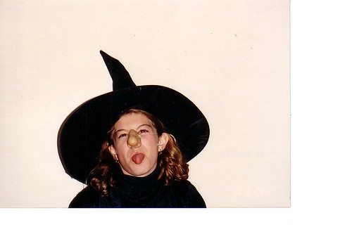A picture of the author at 10 years old sticking her tongue out in a more conservative withc costume