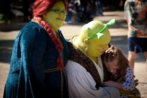"Volunteer actor ""Shrek"" hugs child at Texas Renfest. by Ed Schipul"