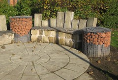 Seating area near bus stop, Cross Houses, Shropshire (wonky knee) Tags: wood uk stone shropshire recycled paving benches reclaimed gabions stoneslabs seatingarea clayheads crosshouses