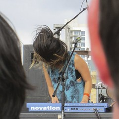 picture two of three of Yuki Chikudate's at the keyboards, her hair blowing up