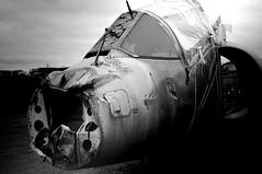badly beaten (f3liney) Tags: blackandwhite abandoned plane artistic takumar aircraft 28mm jet m42 damage theme wreck damaged beaten derelict challenge wrecked harrier themes cnam