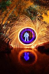(quornflake) Tags: longexposure blue orange lightpainting man reflection wool water night fire spooky lighttrails glowstick sparks