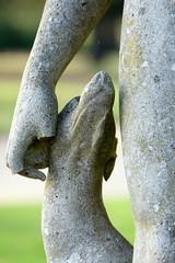 Don't bite the hand that feeds... (SteveJM2009) Tags: uk november dog art statue stone nose hand arm head nt leg hampshire graceful chin muzzle stevemaskell missingfingers mottisfont hants 2011 lovinglook