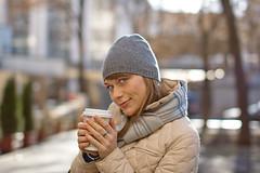 Olga. Coffee1 (azaikina) Tags: city november blue autumn light portrait sun cold color coffee girl beauty smile hat yellow canon hair happy 50mm grey eyes dof drink russia bokeh moscow 14 sigma olga 2011 sigma50mm14
