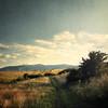 9/30: Șopa (next_in_line) Tags: road sky mountain field clouds 35mm landscape path romania transylvania apsc texturebypareeerica șopa