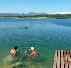 Bathing and relaxing in Slovenia (Bn) Tags: blue boy vacation sky people lake holiday plant green nature water girl standing swimming swim children relax geotagged pier swan hands sailing power joy lakes relaxing thermo slovenia valley enjoy local bathing lush relaxation sporting pleasure discover eldery top50 50faves velenje aleka geo:lon=15081933 geo:lat=46370896