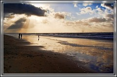 On the beach in November (*Psycho Delia*) Tags: sea sky people reflection beach flare formby topazadjust mygearandme