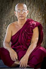 Monk under the Bodi tree - Myanmar (Burma) (Steven Goethals) Tags: travel portrait people face pagoda burma buddhist decoration culture monk buddhism peoples explore human 7d myanmar asie ethnic birma mandalay visage budhist ethnology budhism birmanie mahamuni ethnique stevengoethals