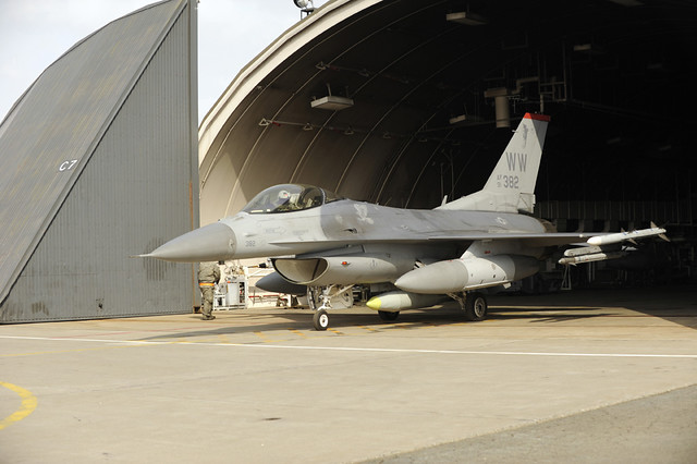 An F-16 Fighting Falcon from a hardened aircraft shelter.