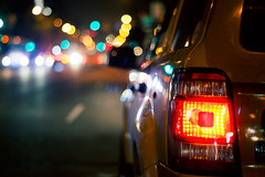 [153] Those night lights remind me of bright eyes. (Linh H. Nguyen) Tags: street nyc colors night lights bokeh taxi 365 rokkor bokelicious nex5n