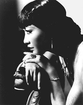 black and white photo of Anna May Wong looking to the side