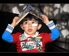 (ll.dyala.ll) Tags: camera portrait sunglasses canon 50mm book child 50 ahmed 500d a7mad  2011    dyala