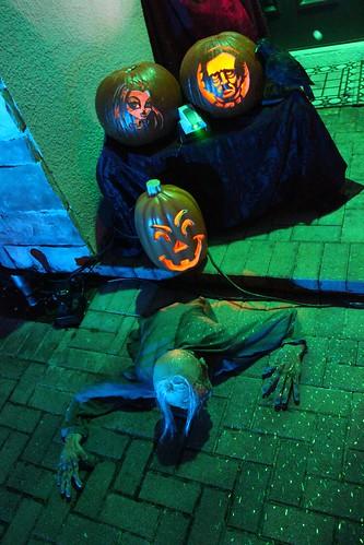 Front door zombie and pumpkins