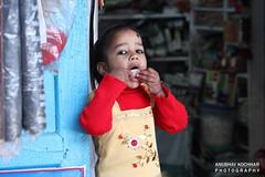 Girl Enjoying Candy (Anubhav Kochhar) Tags: portrait people slr girl kids digital canon fun photography eos rebel kiss candy market joy telephoto dslr efs lansdowne zoomlens t3i x5 telezoom anubhav garhwal 600d f456 kochhar uttrakhand flickraward 55250mm flickrtravelaward soloindiantraveller anubhavkochhar airingbyway