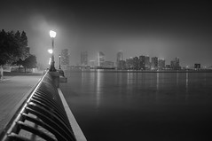 Night on the Hudson (bradmo) Tags: nyc newyorkcity blackandwhite newyork fog night jerseycity manhattan noflash batterypark fujifilm hudson exchangeplace x100 silverefex