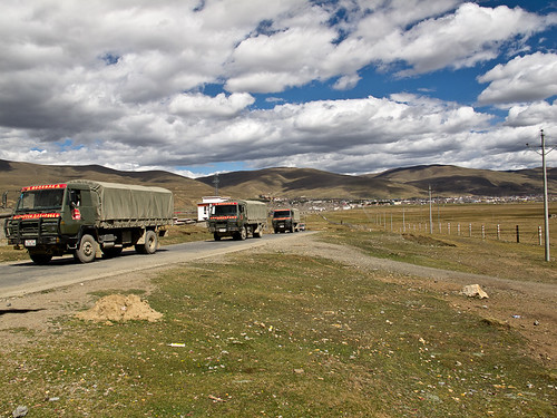 Army supply trucks outside Litang