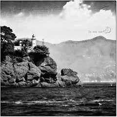 The lighthouse at Portofino (in eva vae) Tags: sea blackandwhite bw italy panorama seascape art water monochrome canon rocks niceshot liguria portofino squared textured orton wawes eos500d eosrebelt1i inevavae mygearandme ringexcellence musictomyeyeslevel1 flickrstruereflection1
