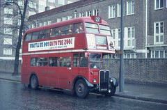 London Transport . RT1699 KYY526 . Hammersmith Road , Kensington Olympia . April-1970 . (AndrewHA's) Tags: bus rain lights olympia kensington tungsten highgate regent saunders londonbus londontransport route27 aec rt1699 kyy526