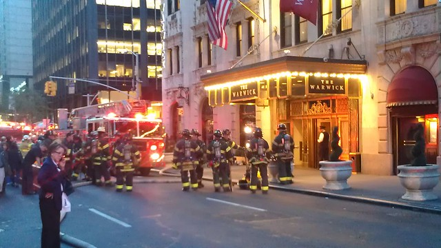 Firefighters at the entrance to the Warwick Hotel