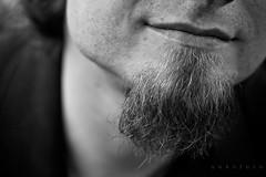 the beard. (anksfoto) Tags: boy portrait bw man smile closeup canon beard 50mm blackwhite 50mm14 lips chin closer