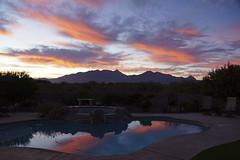 Sunrise at Cactus Camp (ePut) Tags: arizona sky orange usa cloud mountain reflection nature pool sunrise outdoors photography nopeople scene tranquil scenics majesty mountainrange colorimage beautyinnature santaritamountains horzontal cactuscamp sonyslta77v