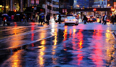 Rainy Night @ Waterfront Station (Explored) (. Jianwei .) Tags: street city bridge red urban wet colors rain station yellow night vancouver umbrella reflections 50mm lights downtown waterfront traffic walk sony afterwork rainy 365   a500  jianwei kemily