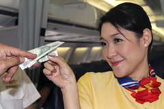 it's only money! (2bsimple) Tags: travel woman money cute girl smile female work fun thailand happy asia southeastasia young lifestyle charm crew thai playful havingfun flightattendant baht crewmember cabincrew itsonlymoney totallythailand airlineaviation
