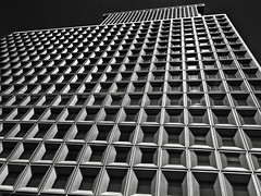 Converging (headcycle) Tags: new york windows bw white ny black building glass architecture canon manhattan line illusion bending