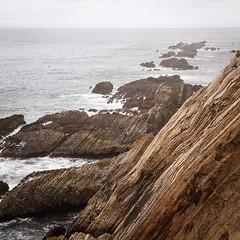 Point Arena, CA (Chicken) Tags: ocean california sea cliff usa seascape water square landscape grey coast beige rocks pacific overcast diagonal getty hazy pointarena