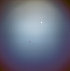 tiny planes (LOLren) Tags: blue sky moon plane dark holga lomo dusk tiny poppytalk summercoloursweek