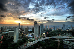 Singapore Sunset (` Toshio ') Tags: road city trees sunset storm clouds singapore cityscape traffic freeway esplanade cbd hdr highdynamicrange centralbusinessdistrict toshio singaporeflyer