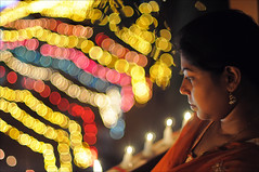 Light of the Soul.... (Saptak Ganguly) Tags: light woman india 50mm bokeh f14 culture diwali westbengal siliguri 2011 d90 saptak
