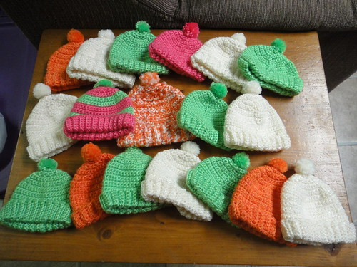 A heap of baby hats.