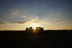 The autumn sun, setting behind Stonehenge