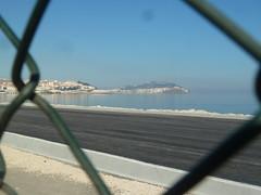 Spanish Ceuta through the Moroccan land border fence (markpanama) Tags: africa fence spain border morocco ceuta